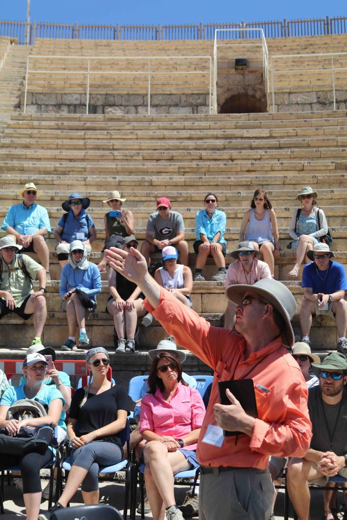 Pastor Tim McCoy explains a point while teaching in a theater at Caesarea. Many events in the book of Acts happened in this location.