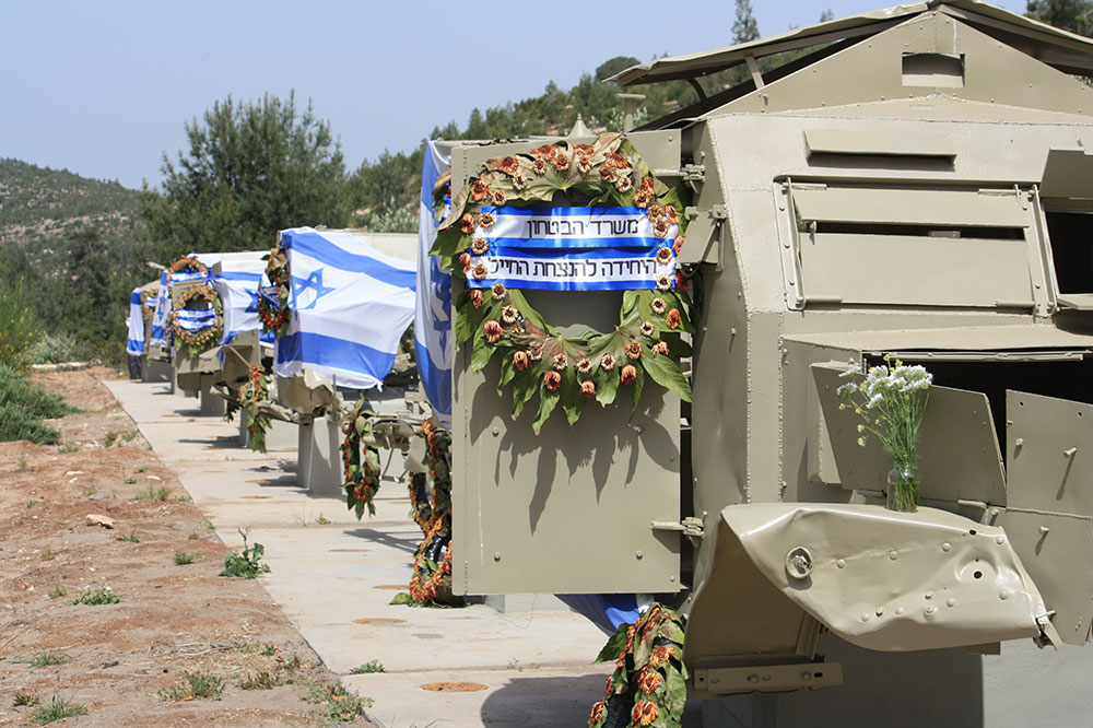 These War Damaged Frames Of Small Armored Vehicles Alongside Highway 1 Are Decorated In Celebration Israels 70s Birthday